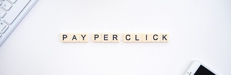 "Scrabble tiles spelling out ""Pay Per Click"""