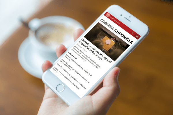 Cornell news website shown on a smartphone
