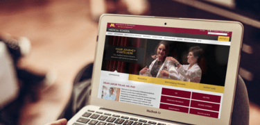 UMN Med School website shown on a laptop