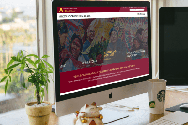 UMN Academic Clinical Affairs website shown on a desktop monitor