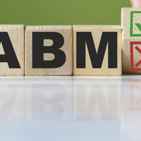 Wooden blocks with the letters A B M on them